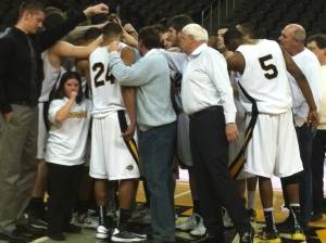 Jillian managing the NKU men's basketball team.